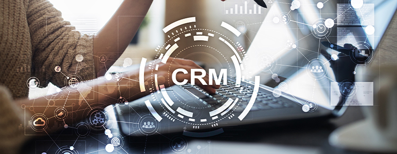 CRM graphic over laptop